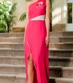Asymmetric long dress with a flower on the shoulder