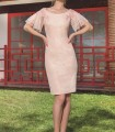 Short pink dress embroidered on the sleeves