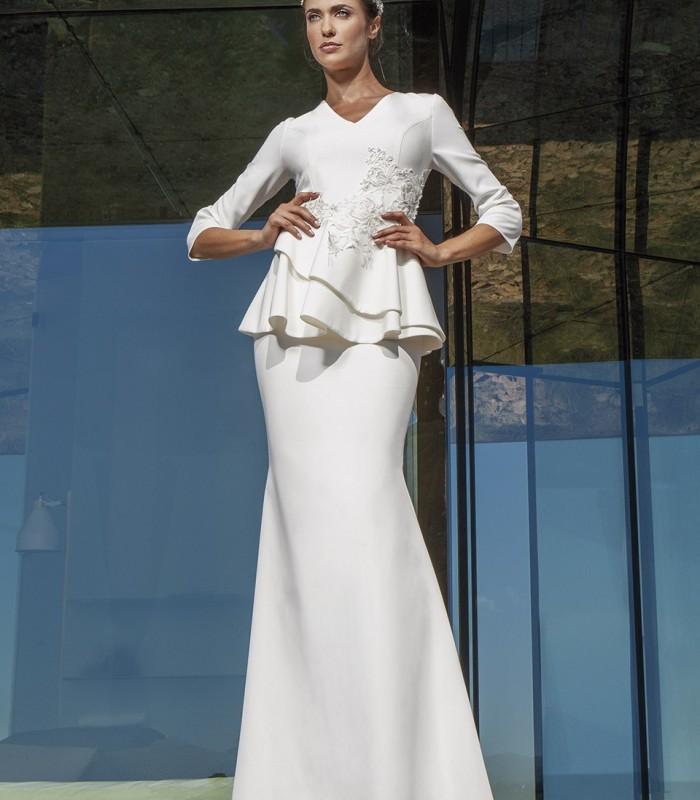 Ivory long sleeve peplum dress