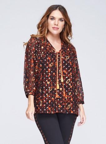Blusa estampada con borlones