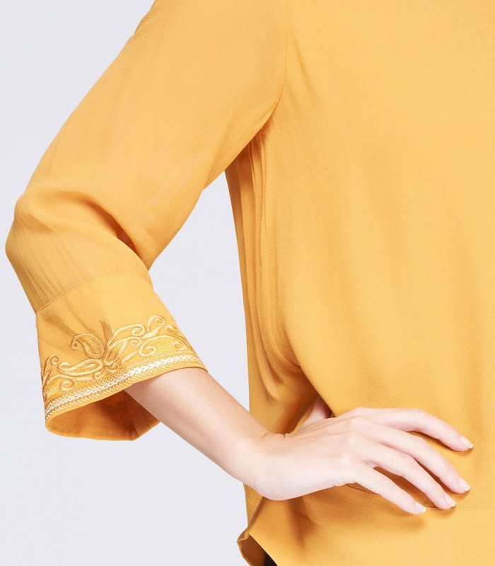Embroidered cuff blouse