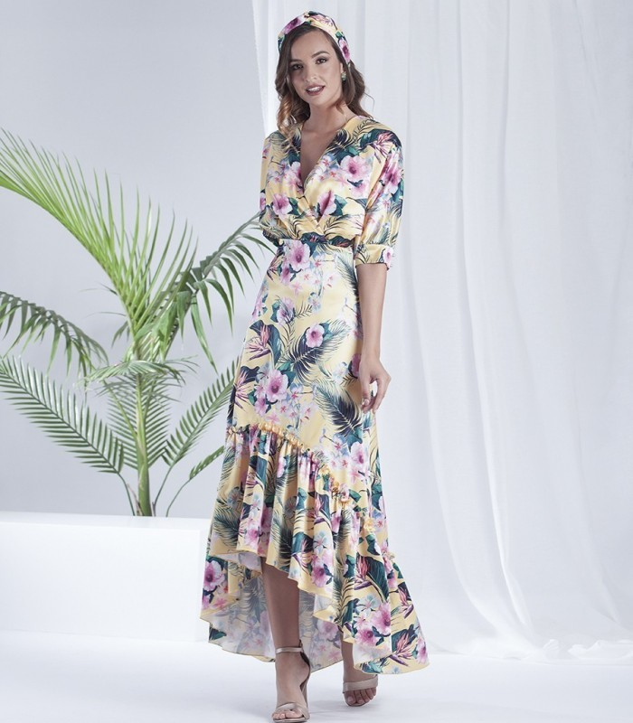 Yellow long dress with asymmetric print with ruffles on the skirt