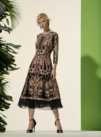 Printed midi dress with semi-sheer neckline.