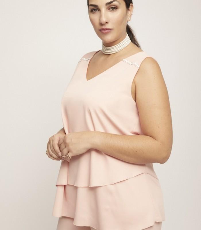 Top rosa con apliques de perlas