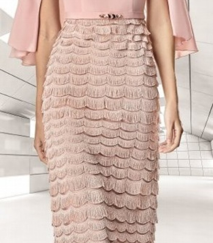 Long pale pink dress with fringed skirt in slings