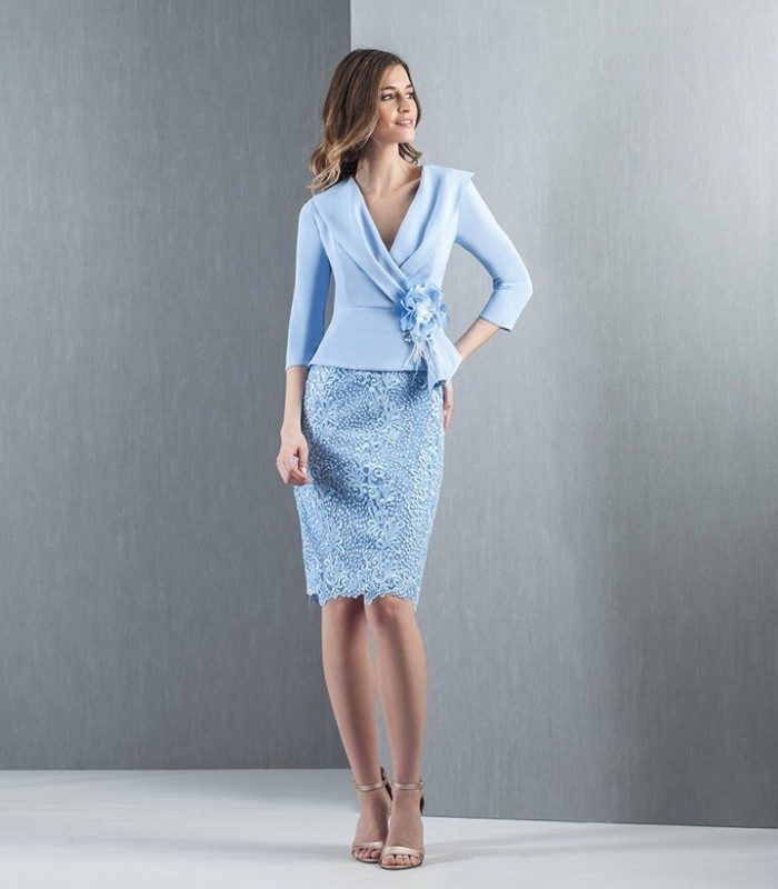 Light blue embroidered dress by Moncho