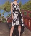 Vestido midi asimétrico con estampado blanco y negro