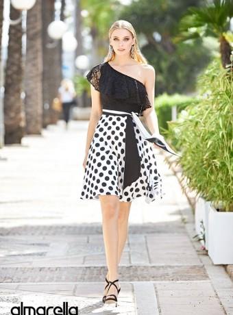Two-tone midi dress with asymmetric neckline and polka dot skirt