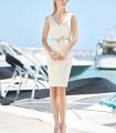 Conjunto Marbella de abrigo y vestido midi blanco