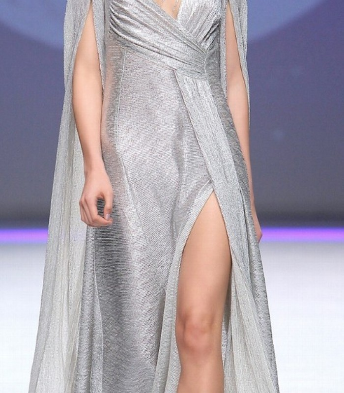 Long dress with asymmetrical neckline and cape sleeves