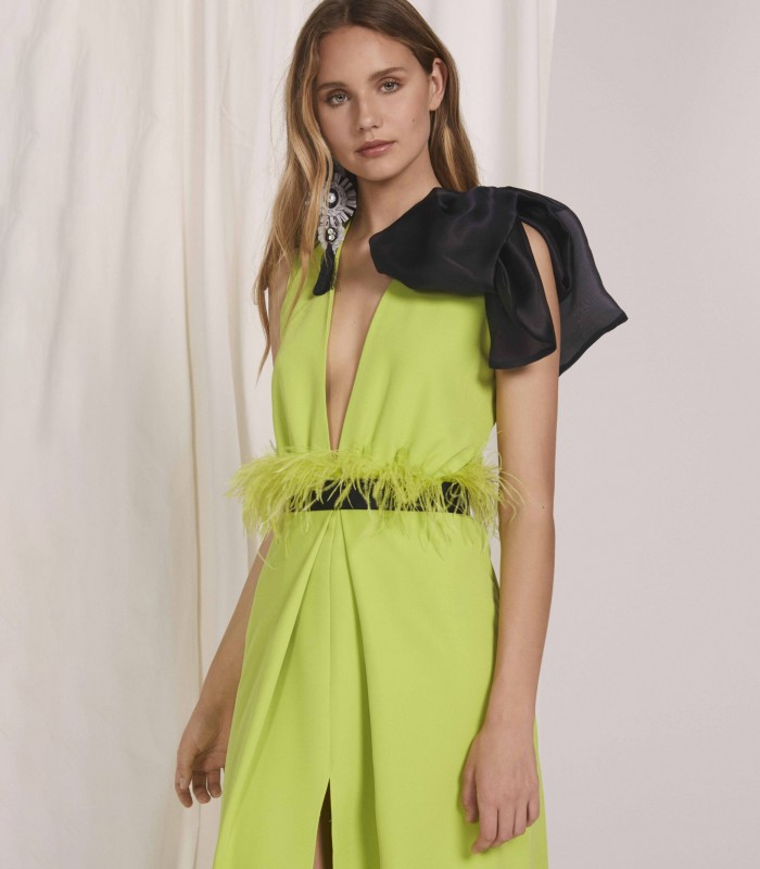 Long dress with deep neckline and front slit in the skirt