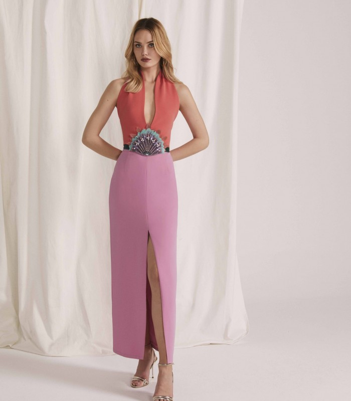 Long double-tone dress with deep neckline and central opening in the skirt