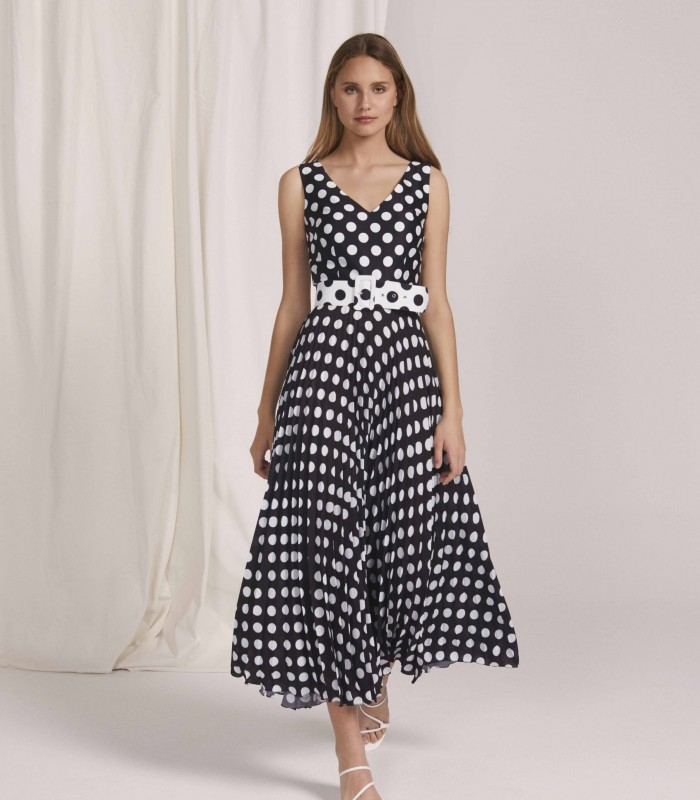 Long polka dot dress with V-neckline and pleated skirt