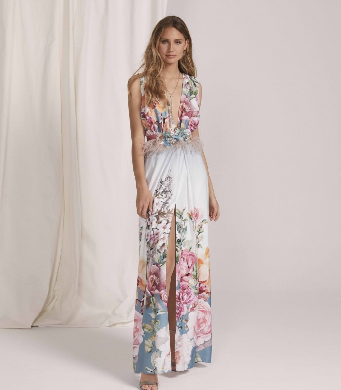 Long printed dress with plunging neckline and central slit in the skirt