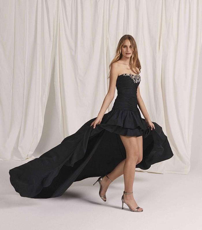 Vestido corto con palabra de honor con falda bolero y cola panel