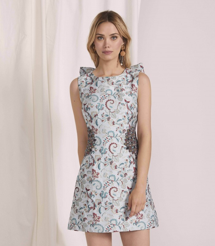 Embroidered short dress with floral appliqué and bow at the back