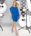 Short straight lace dress with asymmetric cape