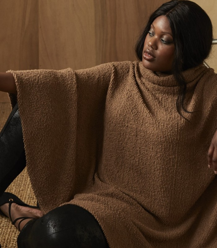 Knitted poncho with V-shaped silhouette and high neck