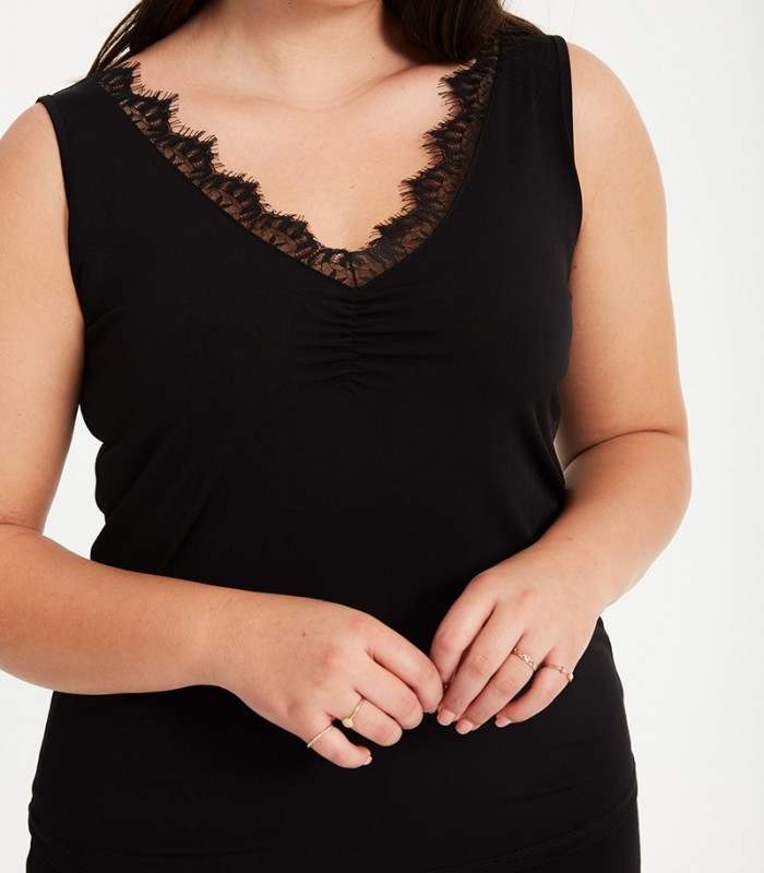 Sleeveless top with lace at the neckline and gathered