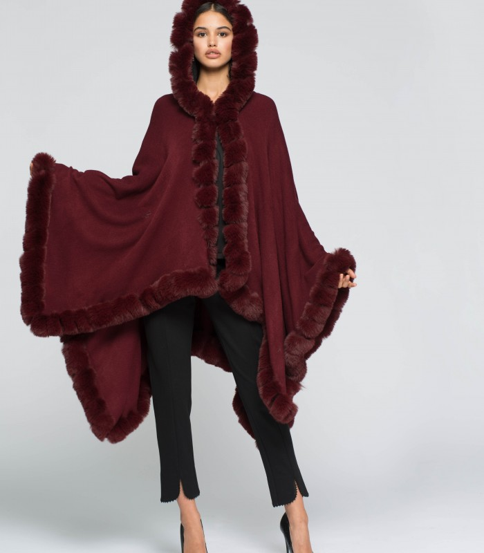 Poncho combined with faux fur at the ends and hood
