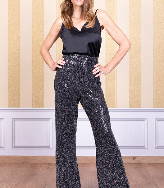 Shiny high-waisted trousers with flared at the end