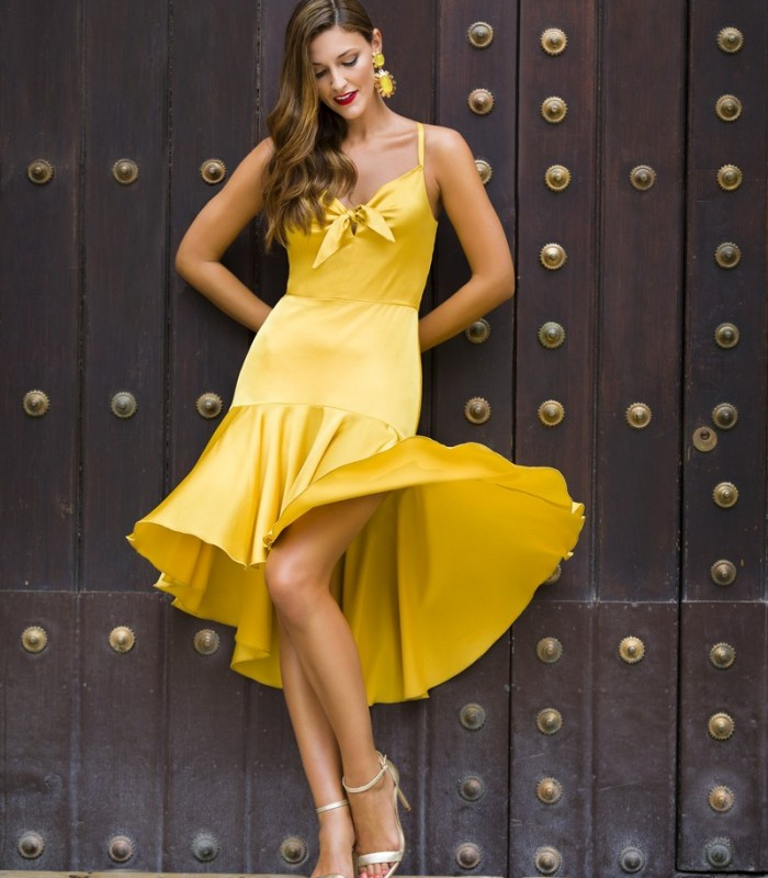 Midi flared dress with bow at the neckline