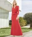 Long V-neckline dress with peplum and flower bow