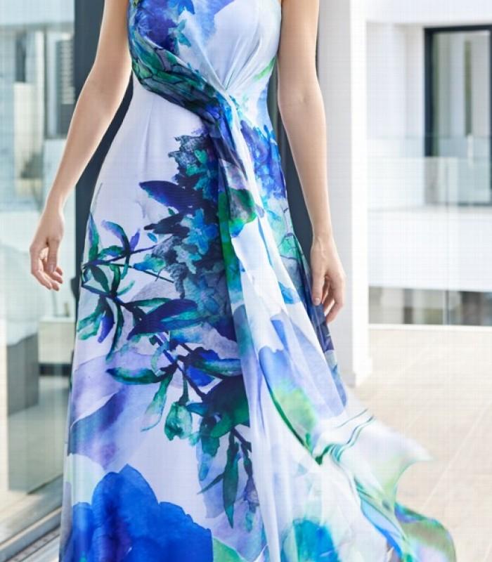 Vestido largo de estampado colorido con detalle de flor en una manga
