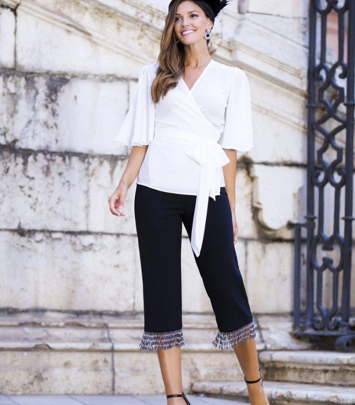 Wrap blouse with ruffle sleeves and bow to one side