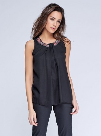 Black top with embroidered and folded neckline